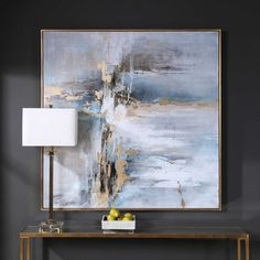Our Road Less Traveled Painting is a hand-painted abstract on canvas with light grey and blue tones with gold leaf accents and an antique gold leaf gallery frame. Due to the handcrafted nature of this artwork, each piece may have subtle differences. Designed by Carolyn Kinder International for Uttermost Company.
