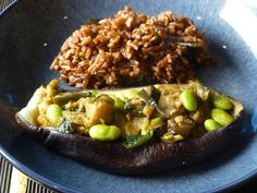 Aubergine boats with soy beans and ginger served with red rice