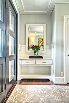 modern entryway table mirror hardwood floors carpet drawers double doors vase transitional design of An Awesome Modern Entryway Table List to Get a Look At