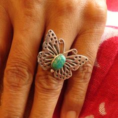 A delicate, lovely and finely tooled butterfly ring, with silver wings and a thorax of Fox turquoise . . . the sweetest little butterfly to land on your finger ever.