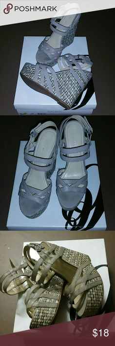 "Soft Gray Nine West platform sandals 5"" heel with 2.5 platform soft gray straps very buttery weather feel with gorgeous hey leaving in great condition. Size 8.5 Nine West Shoes Platforms"