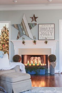 Christmas Mantel with reclaimed wood star and Holly Jolly sign.  Love the birch logs in the fireplace!