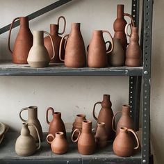 Brooklyn based potter Helen Levi. The thin handles on these jug / pitcher forms are beautifully poetic. http://helenlevi.com