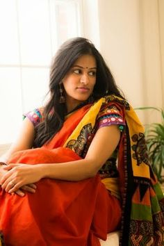 An orange colored Cotton saree with kalamkari work , paired with mirror work blouse. Love the look.