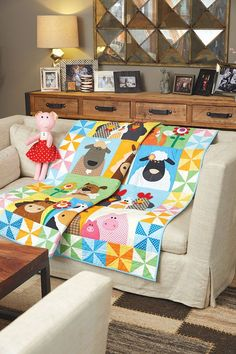 Welcome to Windy Hill, where the sun is always shining and the air is always sweet. A border of pretty pinwheels and a matching stuffed pal, Penny the Pig, ensures that this Windy Hill Farm Quilt from Happy Quilts by Antonie Alexander will brighten any room.