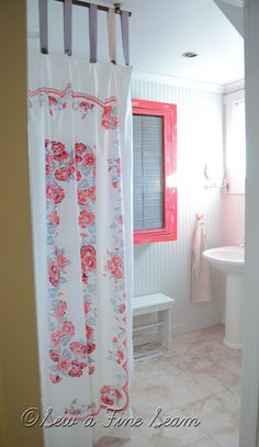 love the vintage tablecloth as shower curtain