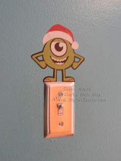 When Monsters Inc and Christmas come together . . .  Hahahaha! I must make a santa hat for the Tink in L's room! Love it!