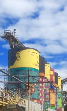 Quirky street art on water towers on Granville Island, Vancouver in British Columbia, Canada.
