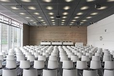 Topography of Terror auditorium in Berlin features Arper's Catifa chairs Meeting Room Hotel, Office Meeting, Corporate Interiors, Office Interiors, Conference Room Design, Office Pictures, Function Room, Co Working, Learning Spaces