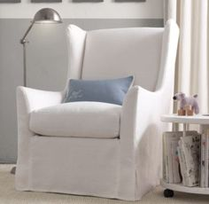 wingback swivel glider with slipcover $1199 - $1849 Click on a swatch to select a base color Fabric: Brushed Cotton        Fabric: Belgian L...