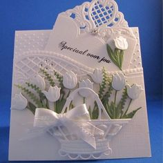 Beautiful White Lacy Embossed Tulip Card...with lacy cutout basket with bow.