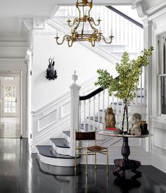 The Laurel Home Best Of Interior Design Awards For 2015 - laurel home | Gorgeous entry with white on white walls and ebony floors by Windsor Smith for Elle Decor
