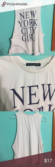 Brandy Melville muscle tee New York City girl muscle tee from Brandy Melville! I'm perfect condition except for the little white mark on the I in city as shown Brandy Melville Tops Muscle Tees
