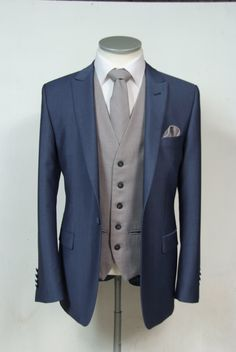 he newest collection to our hire ranges is this Steel blue wool & mohair slim fit grooms wedding lounge suit available from stock from July 2015 shown here with a grey classic wool waistcoat matching tie & pocket square. Complete outfit available to hire for £159.50 #wedding #suit #groomsuit #groomstyle #groom #waistcoat #steelblue