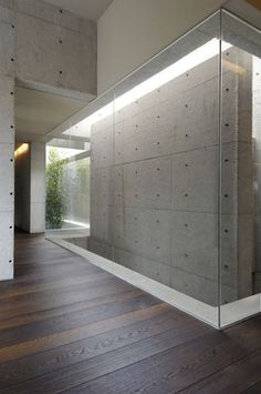 Concrete House by A-cero. I love the combination of wood and concrete.