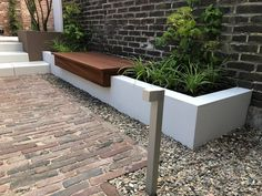 Planter with hardwood bench. A great combination in this industrial garden . - Planter with hardwood bench. A great combination in this industrial garden by Nederveentuinen - Modern Garden Design, Backyard Garden Design, Contemporary Garden, Terrace Garden, Backyard Patio, Backyard Landscaping, Back Gardens, Outdoor Gardens, Garden Seating