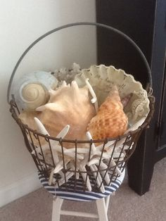 Seaside Cottage Decor...the basket could be filled with flowers, old bottles, sewing accessories, magazines, candles ect
