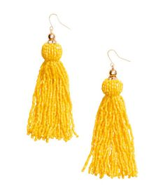 Earrings in metal with small rhinestones and tassels with glass beads. Length 4 1/4 in.