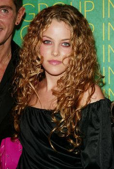 Curly Girl Riley Keough