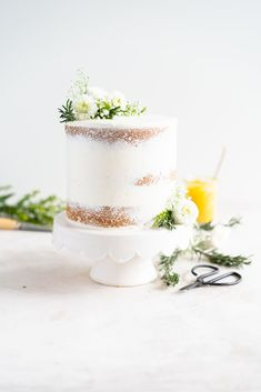 Olive Oil Layer Cake with Meyer Lemon Curd and Rosemary German Buttercream. Fruity olive oil cake is filled with a zesty meyer lemon curd, and finished in a semi naked style with a rosemary german buttercream and spring flowers. Bolos Naked Cake, Cake Dome, Olive Oil Cake, Lemon Curd, Pudding, Recipe Today, Cupcake Cakes, Cupcakes, Dessert Recipes
