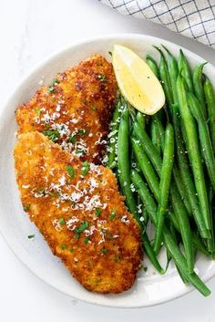 Easy Parmesan crusted chicken is a delicious, easy weeknight dinner recipe. Juicy chicken breasts breaded and cooked until golden makes this Parmesan crusted chicken recipe the perfect easy dinner served with a simple side. Easy Weeknight Dinners, Easy Meals, Cooking Recipes, Healthy Recipes, Easy Cooking, Healthy Fats, Cooking Okra, Oven Recipes, Vegetarian Cooking