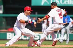 Yadi and Furcal celebrate after beating the Scrubs  5-15-12