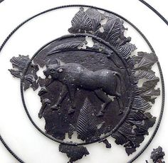 """Exhibition """"Rome´s unknown borders"""": Dacian shield ( century BC ) from Luncani - Piatra Rosie, Bosorod, district Hunedoara - detail: Relief of bos primigenius. 1st Century, First Humans, Bavaria, Warfare, Rome, Celtic, Weapons, Museum, Detail"""
