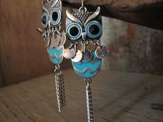 Fun and sassy owls!  The silver-toned owls are accented with turquoise and silver chevron, chain and discs.  A perfect fun accent for your fall outfits.   The earrings are approximately 3 inches long  To view all of our beautiful items and more please visit me at www.TheBuckingMare.com  Be ...
