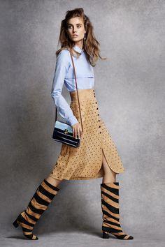 Nina Ricci top, $590, Ikram Chicago, 312-587-1000; Lanvin skirt, $5,150, Saks Fifth Avenue, 212-753-4000, and boots, $1,650, 646-439-0308; Prada earrings, $370, prada.com; Edie Parker bag, $1,795, shopBAZAAR.com.