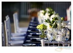 navy blue and green wedding reception tables and centerpieces