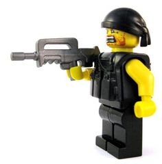 French Assault Rifle - Based on a firearm currently used by the real French Army, the French Assault Rifle is a great custom LEGO gun for all your modern military minifigs. (Try saying that 3 times fast!) The bullpup-style of this weapon allows the gun to be compact, while still being accurate and powerful. #LEGO #Minifigure #BrickWarriors #toys #LEGOGun #MinifigureGun #FrenchAssaultRifle #FrenchArmy #ModernMilitary #Military #AssaultRifle #LEGORifle #LEGOAccessories #MinifigureAccessories