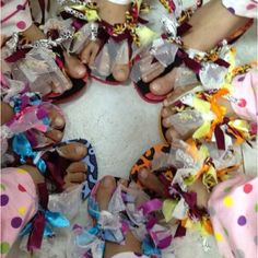 Easy decorated flip flops for slumber party craft.  Just pick up some plain flip flops and tie a knot of different colored material strips onto strap. That's all it takes and the girls have so much fun making them together!