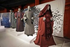 Senate and Trade Federation robes are displayed as part of an exhibit on the costumes of Star Wars on Jan. 29 at Seattle's EMP Museum. |Elaine Thompson | The Associated Press