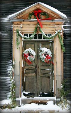 snowy wreaths on a festooned door, shadetree photography