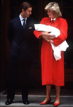 Prince Charles and Princess Diana are spotted leaving the hospital with newborn Prince Harry in this photo from September 1984.