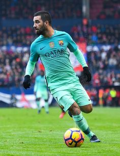 Ardan Turan of FC Barcelona runs with the ball during the La Liga match between CA Osasuna and FC Barcelona at Sadar stadium on December 10, 2016 in Pamplona, Spain.