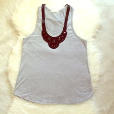 Lush Jeweled Neck Racerback Tank With Satin Bow M Such a casual and fun racerback heather grey tank by Lush Clothing! Features scoop jeweled neckline attached with satin ribbon that can be worn as a bow at the back. Viscose/Spandex blend. Very soft. Size M. Made is USA. From BP, Nordstrom. Excellent condition! Lush Tops Tank Tops