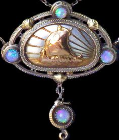 ARTIFICERS' GUILD 1901-1942 Attrib. Viking Long Ship  Arts & Crafts Necklace  Silver Gold Opal Pearl Pendant: H: 5.4 cm (2.13 in)  W: 3.7 cm (1.46 in)  Necklace: L: 50 cm (19.69 in)  British, c.1905