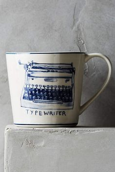 Typewriter Icon Mug by Molly Hatch | Anthropologie (I'd love to have the Eiffel Tower mug too.)