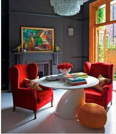 Love dark walls with bright accents and white floors!