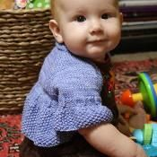 Whirligig shrug, sized for infant to 12 years old.