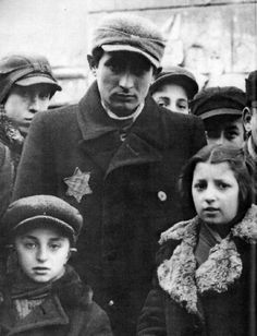 Jewish family wearing the Star of David. The family would soon be gassed by the evil ss nazis