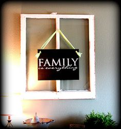 Love this!  Black painted canvas, white vinyl lettering, and an antique window or frame.
