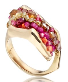 by artist Sophia Mann. The Captured ring is handmade of 18kt gold, yellow diamond beads, sapphires, rubys, apatite, and coral.