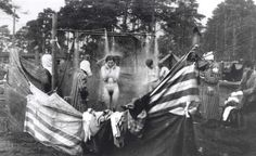Bergen belsen, Germany, Released women prisoners taking a shower in the camp after the liberation, April 1945.