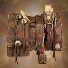 19th century Mexican saddle has lavishly embroidered bull fighting theme