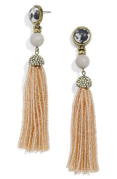 Marbled stone, sparkling crystals and beaded tassels come together on thse antiqued goldtone drop earrings for a modern, standout look.