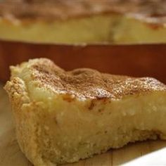 South African recipe - 'Melktert' (Milk tart) - It is a South African dessert. It is a sweet pastry crust containing a creamy filling made from milk, flour, sugar and eggs and dusted with cinnamon. NewGenEggs make this extra delicious South African Desserts, South African Recipes, Tart Recipes, Sweet Recipes, Dessert Recipes, Custard Recipes, Milk Recipes, Easy To Make Desserts, Food To Make
