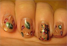 Beautifully painted leaf nail art design. A really pretty and cute nail art design with multi colored leaves falling from the tree depicting your typical autumn scenes.