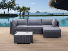 SANO patio conversation set made out of dark grey wicker with grey, soft cushions.